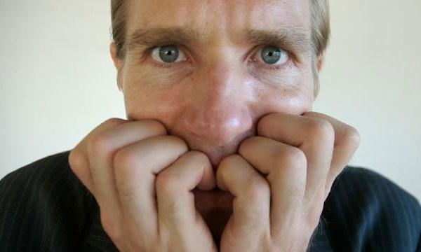 nervous man biting his nails_1798624098015093-159532