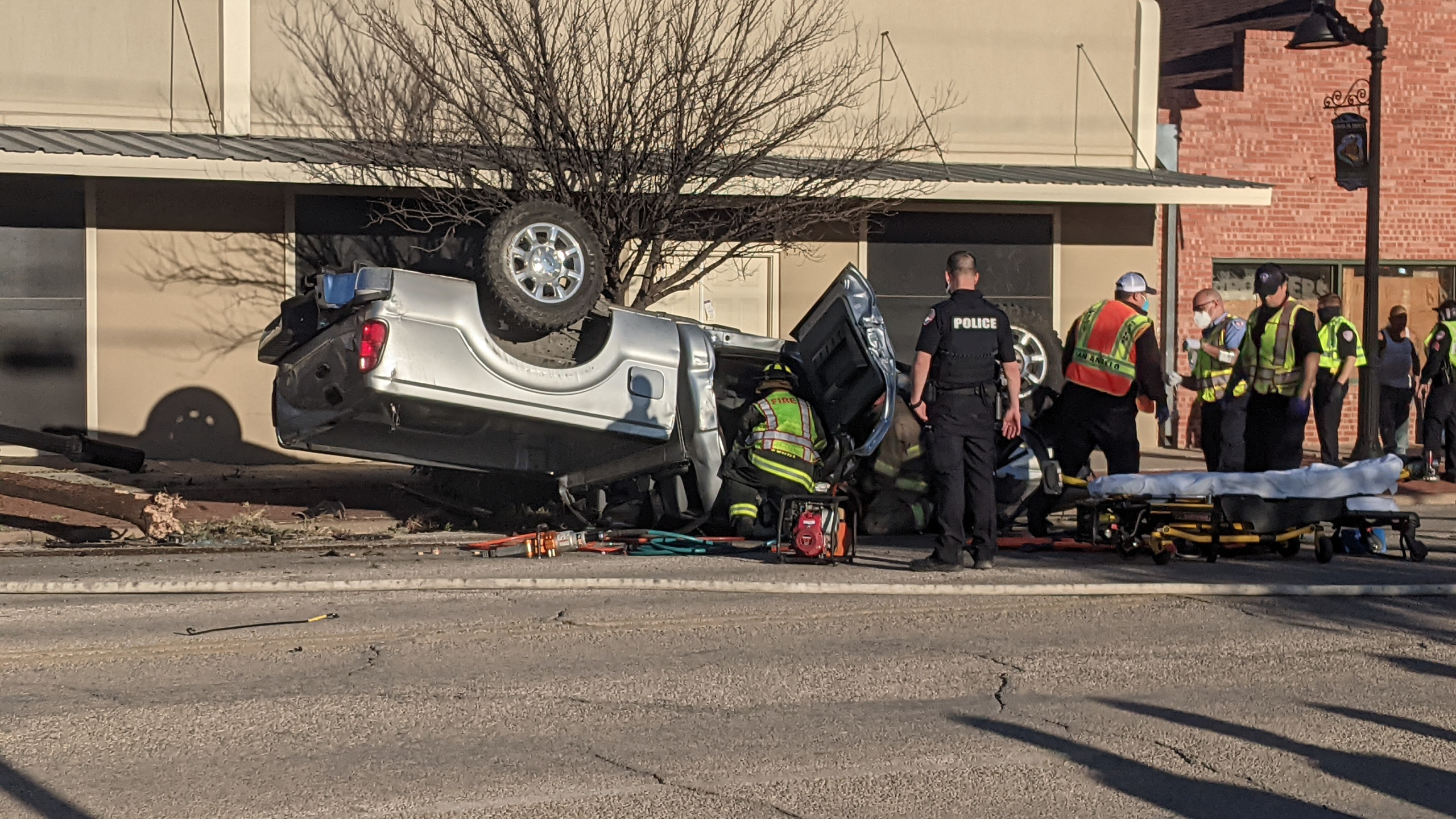 Overturned and badly damaged silver Ford F-150