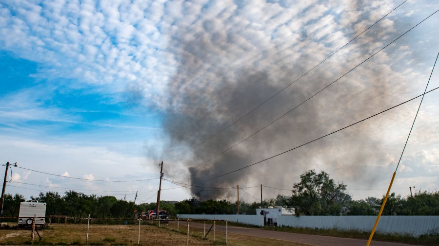 Smoke from a structure fire on the 10000 block of Cottontail Lane in Grape Creek, September 21, 2021